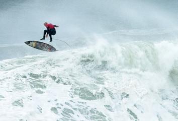 Australian surfer Justen Allport escapes a wave during the Cape Fear surfing tournament in heavy seas off Sydney's Cape Solander in Australia