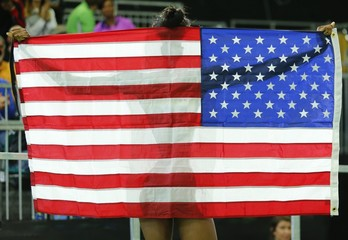 Bronze medalist Hayes of the U.S. holds up an American flag as she celebrates after the women's 400 meters final at the IAAF World Indoor Athletics Championships in Portland