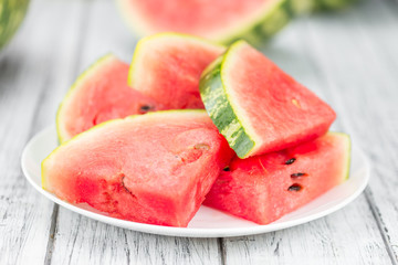 Portion of Fresh Watermelon on wooden background (selective focus).