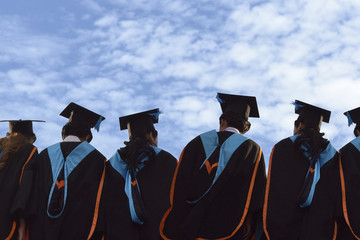 Graduates in university degree graduation,The background image is blue sky.