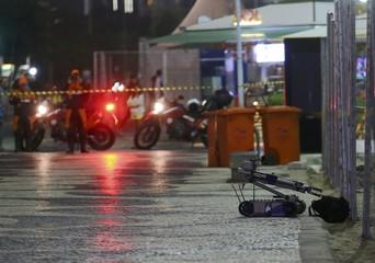 A robot removes a suspicious backpack, near Copacabana Beach, in Rio de Janeiro