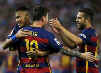 Barcelona's Messi celebrates with team Neymar and Alba after scoring a goal against Atletico Madrid during their Spanish first division soccer match at Vicente Calderon stadium in Madrid