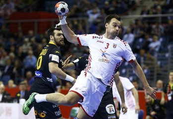 Maric of Croatia attemps to score against Spain during their Men's European Handball Championship match in Krakow