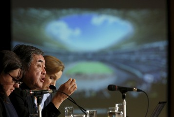 Kuma, an architect and the designer of a New National Stadium, speaks in front of a screen displaying his new national stadium design during a news conference at the Foreign Correspondents' Club of Japan in Tokyo