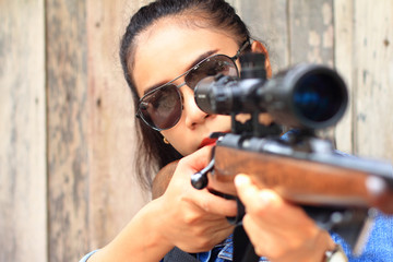 The woman at the shooting range shot from a rifle