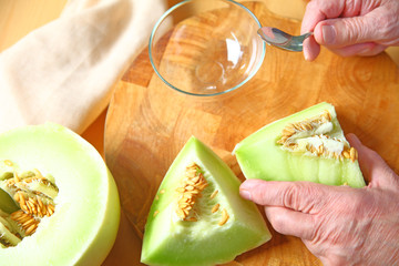 Man preparing honeydew melon