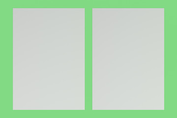 Two blank white flyers mockup on green background