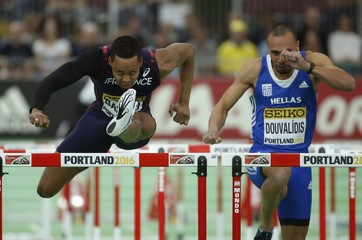Bascou of France runs in the men's 60 meter hurdles during the IAAF World Indoor Athletics Championships in Portland