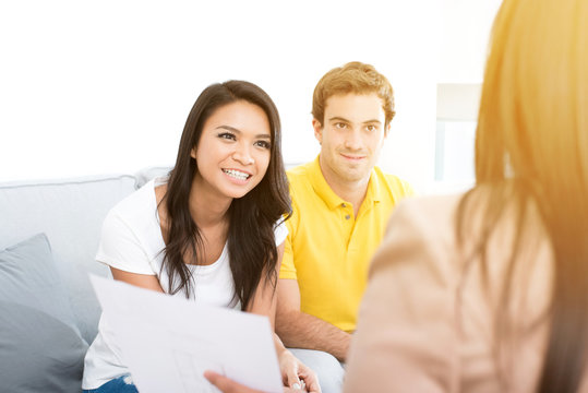 Young interracial couple meeting with consultant