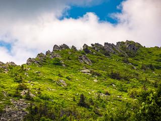 huge rocks on the edge of a mountain ridge