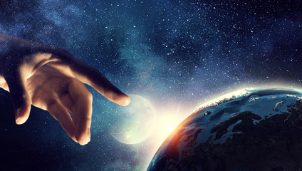 Touching planet with finger Wall mural