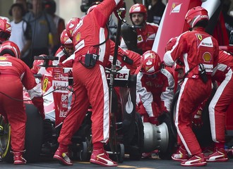 Mechanics work on the car of Ferrari's Formula One driver Sebastian Vettel of Germany in the pits during  Mexican F1 Grand Prix at Autodromo Hermanos Rodriguez in Mexico City