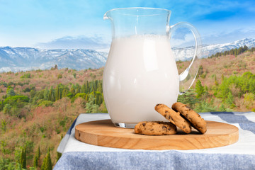 Pitcher  with some milk