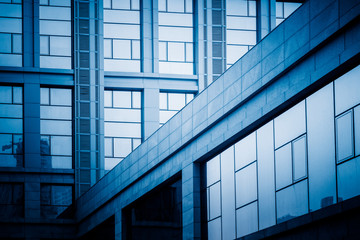 detail shot of modern architecture facade,business concepts in blue tone,shot in city of China.