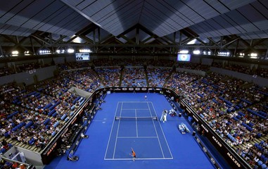 Japan's Nishikori serves during his third round match against Spain's Garcia-Lopez, with the roof closed due to rain at Margaret Court Arena, at the Australian Open tennis tournament at Melbourne Park