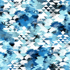 Seamless pattern tie-dye design with navajo triangles. Indigo background with watercolor effect. Textile shibori print for bed linen, jacket, package design, fabric and fashion concepts.
