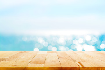 Wood table top on blur summer blue sea and sky background