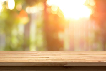 Wood table top on shiny bokeh abstract background