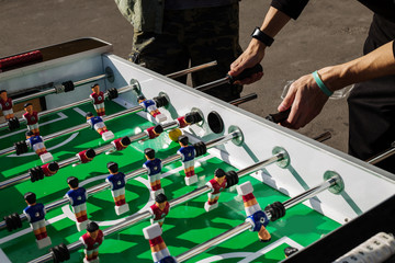 People Playing Enjoying Football Table Soccer Game Recreation Leisure