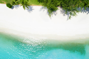 Aerial drone shot of white sand beach with turquoise sea water