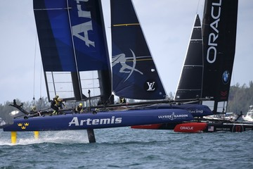 AC45F racing sailboat Artemis Racing crosses ahead of Oracle Team USA during race 3 on their way to winning the America's Cup World Series sailing competition on the Great Sound in Hamilton