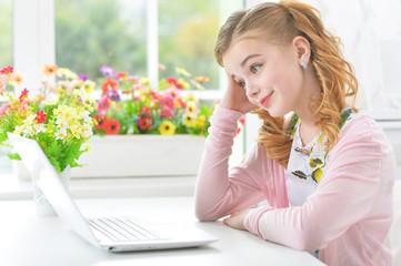 Little girl with modern laptop