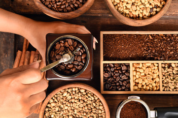Freshly coffee beans in bowl  and coffee beans in coffee grinder for background