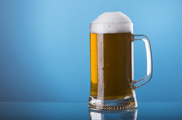 Light beer mug against the backdrop of the bar shelf