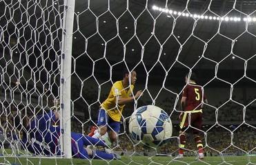 Ricardo Oliveira of Brazil celebrates after scoring past goalkeeper Alain Baroja of Venezuela during their 2018 World Cup qualifying soccer match in Fortaleza