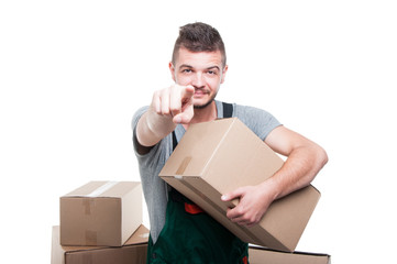 Mover guy holding cardboard box pointing camera