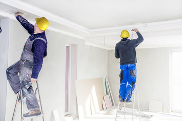 Construction workers fill the ceiling