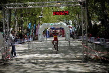 Spanish mountain biker Jose Marquez, 40, celebrates as he crosses the finish line to win the cycling category in the XIX 101km international competition in Ronda
