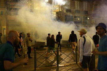 England fans run through tear gas in Lille - Euro 2016