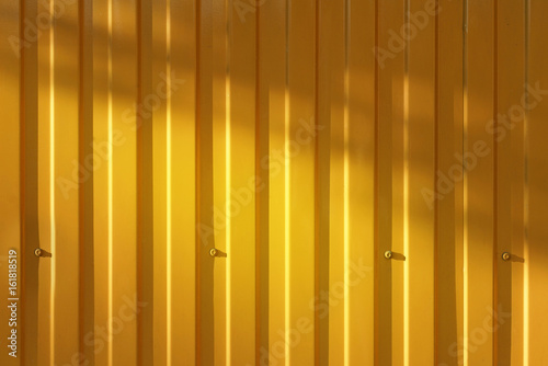 picket fence texture.  Fence A Corrugated Fence Of Yellow Metal Sheets With Screw Texture  Picket Profile On Picket Fence