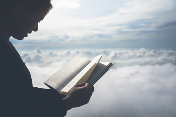 Women relax Read morning book good weather sky Mist. On the mountains, the morning atmosphere.