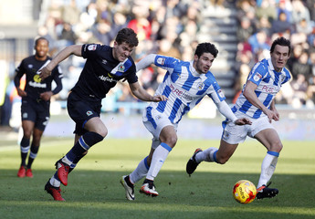 Blackburn Rovers' Sam Gallagher (L) in action with Huddersfield Town's Christopher Schindler (C) and Dean Whitehead
