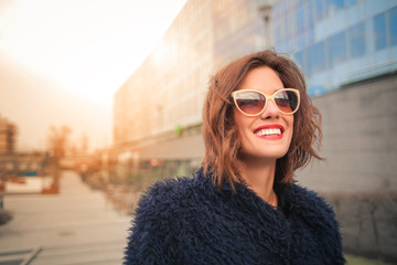 Beautiful woman wearing stylish sunglasses