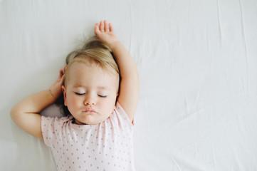 Sleeping one year old baby girl