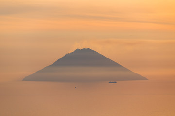 Active volcano Stromboli view at sunrise sunset from Salina Eolian island in Sicily Italy in summer