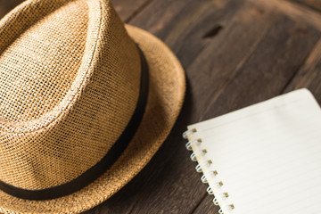 Notebook with hat in writing concept.