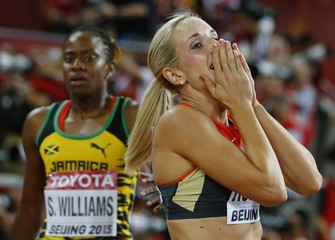 Roleder of Germany celebrates next to Williams of Jamaica after women's 100 metres hurdles final at 15th IAAF World Championships in Beijing