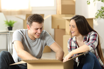 Couple moving home packing belongings