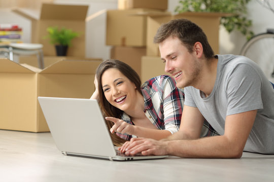 Couple moving house searching on line