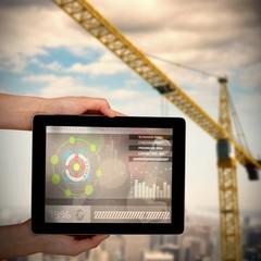 Composite 3d image of close-up of hands holding digital tablet