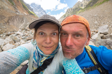 Couple of funny travelers taking selfie