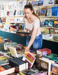 Woman buying textbooks