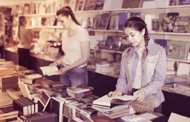 Smiling daughter is flipping books