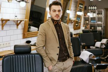 Attractive man at barbershop background