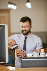 Handsome man at doing coffee