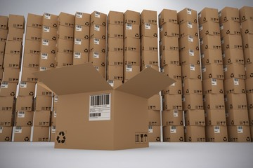 Composite image of open cardboard box against pile of boxes